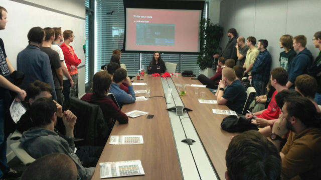 Photo of Radka speaking - about to write some code